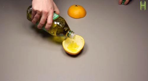 Candela arancio e olio